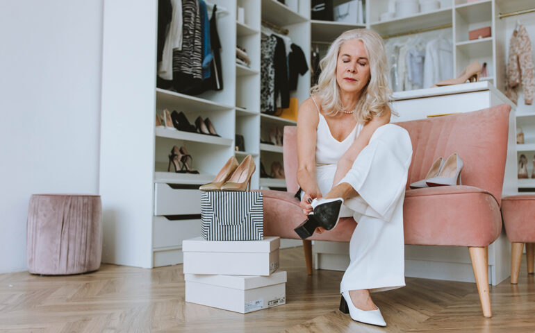 Woman trying expensive shoes