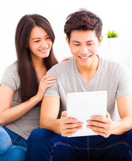 Young Couple with a mobile device creating digital asset estate plan